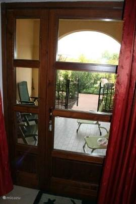 The front door overlooking the covered front terrace and the garden / pool