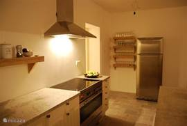 Kitchen with all conveniences, including a five-burner stove
