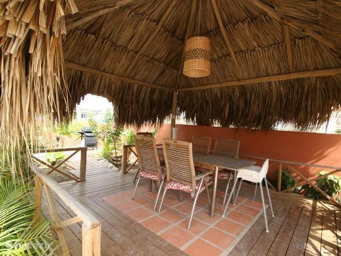 In the palapa in the garden with outdoor kitchen, enjoy cozy evenings bbq