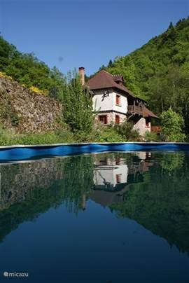The pool with the mill in the background