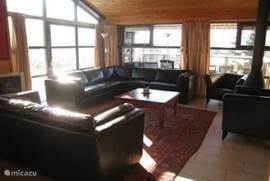 spacious living room with sofa, fireplace and color TV with satellite receiver. There are plenty of Dutch stations to receive. There are several board games available.