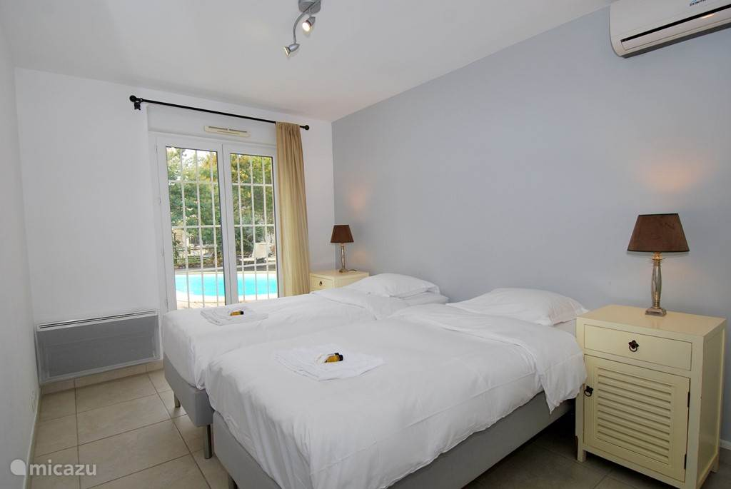 Four bedrooms with double box spring beds, all bedrooms have air conditioning
