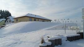 Winter view of the bungalow in the snow