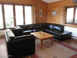 Lounge with large sofa, TV, DVD and internet.