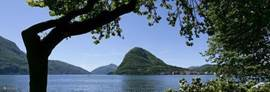 View of Lake Lugano and the surrounding mountains