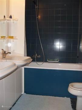 Bathroom with bath and double washbasin, toilet