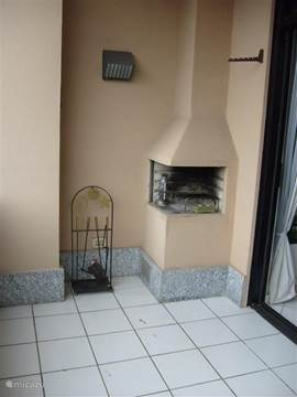 Outdoor fireplace on balcony