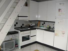 Kitchen, with oven, dishwasher and fridge / freezer.