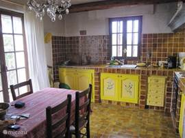 the cozy kitchen where all French Provencal dishes can be cooked and eaten