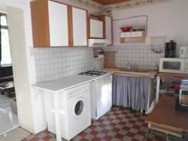 A fully equipped kitchen with microwave, dishwasher.